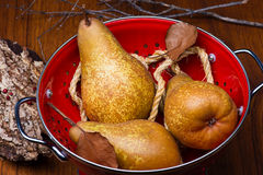 Pears on red colander Royalty Free Stock Photography