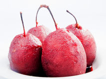 Pears with red wine Stock Images