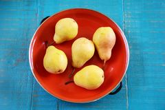 Pears. Ripe pears in enamel bowl on wooden background Stock Photography