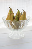 Pears. Ripe pears in a glass bowl Royalty Free Stock Photography
