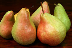 Pears - ripe and juicy. Delicious juicy pears on the dark wooden background Royalty Free Stock Photography