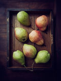 Pears. On a rustic tray Royalty Free Stock Photos