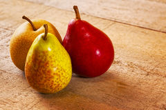 Pears on a Rustic Wood Surface Royalty Free Stock Image