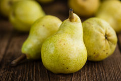 Pears (selective focus). On an old wooden table (close-up shot Stock Images