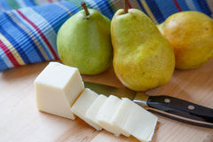 Pears and Sliced Cheese with Colorful Placemat Royalty Free Stock Photo
