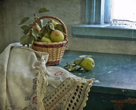 Pears are in a small basket Royalty Free Stock Photos