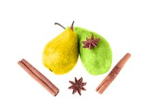 Pears and spices isolated on white. Yellow and green pear, cinnamon and aniseed isolated on white background Stock Photography