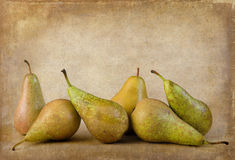 Pears still life on grunge background Royalty Free Stock Photos