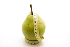 Pears on tape measure Stock Photos