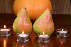 Pears and tealights Royalty Free Stock Image