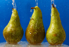 Pears under water streams Royalty Free Stock Photo
