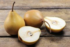 Pears. (variety Beeregrie) on wooden background Royalty Free Stock Photo