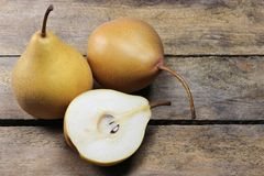 Pears. (variety Beeregrie) on wooden background Stock Photos