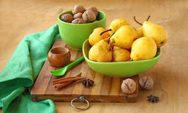 Pears,  walnuts, cinnamon and ginger on a kuchen Royalty Free Stock Image