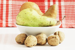 Pears and walnuts in the kitchen. Some pears and walnuts on a kitchen table Stock Photography