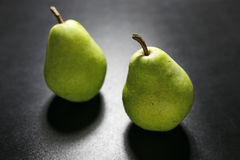 Pears with water drops on black background Stock Photography