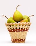 Pears. Wattled basket with ripe pears Royalty Free Stock Images