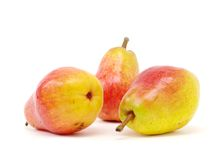 Pears on white. Three red yellow pears on white isolated Stock Photos