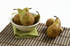 Pears in white bowl Royalty Free Stock Image