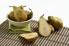 Pears in white bowl Stock Image