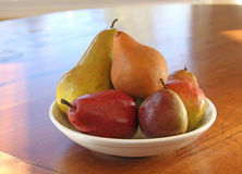 Pears in a white bowl on Wooden Table Stock Images