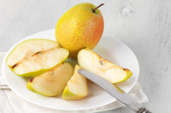 Pears on white plate Stock Photos