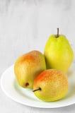 Pears on white wood Stock Photos