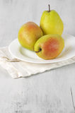 Pears on white wood Royalty Free Stock Photography