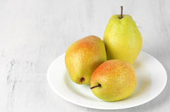 Pears on white wood Stock Image
