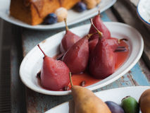 Pears in wine. Christmas menu Royalty Free Stock Photo