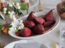 Pears in wine. Christmas menu Stock Photos
