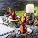 Pears in wine. Romantic dinner Royalty Free Stock Photos