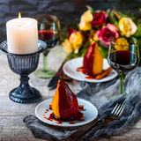 Pears in wine. Romantic dinner Stock Photography