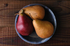 Pears on Wood Table and Blue Plate Stock Photography