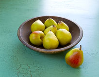 Pears in a wooden bowl Stock Photo