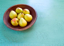 Pears in a wooden bowl. On a rustic table with copy space Royalty Free Stock Images