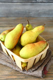 Pears in a wooden box Stock Photos