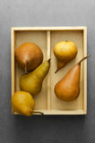 Pears in wooden box Stock Photos