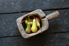 Pears in wooden box on vintage table Stock Photos