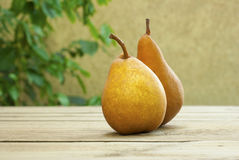 Pears on wooden table Royalty Free Stock Photos