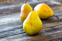 Pears on wooden table Stock Photos