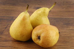 Pears on wooden table royalty free stock image