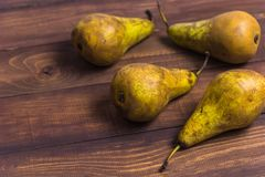 Pears on a wooden table. Four pears on a wooden table copy space Royalty Free Stock Image