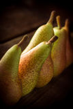 Pears on wooden table. Pears group on wooden table and dark background Stock Image