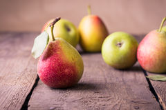 Pears on a wooden table Stock Photos
