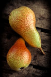 Pears on wooden table. Two pears on old rustic wooden table Stock Images