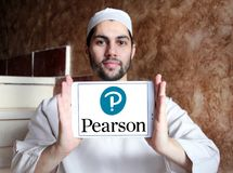 Pearson education company logo. Logo of Pearson company on samsung tablet holded by arab muslim man. Pearson plc is a British multinational publishing and royalty free stock image