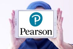 Pearson education company logo. Logo of Pearson company on samsung tablet holded by arab muslim woman. Pearson plc is a British multinational publishing and royalty free stock images