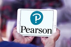Pearson education company logo. Logo of Pearson company on samsung tablet. Pearson plc is a British multinational publishing and education company stock photography
