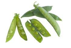 Peas. Pods on a white background royalty free stock photos